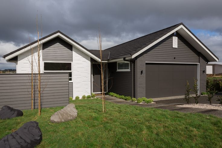Waiata combination cladding of painted brick and weatherboard...