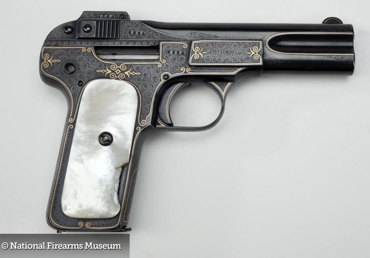 ROOSEVELT'S FN MODEL 1900 PISTOL: Theodore Roosevelt's personal pistol is factory engraved in tight english scroll with gold line inlay and mother of pearl grips. Family tradition holds that this semi-automatic pistol was one that Theodore Roosevelt used as a nightstand gun during his years in the White House. In fact, when a family member brought it to the NRA to donate many years ago, it arrived fully loaded with a round in the chamber.