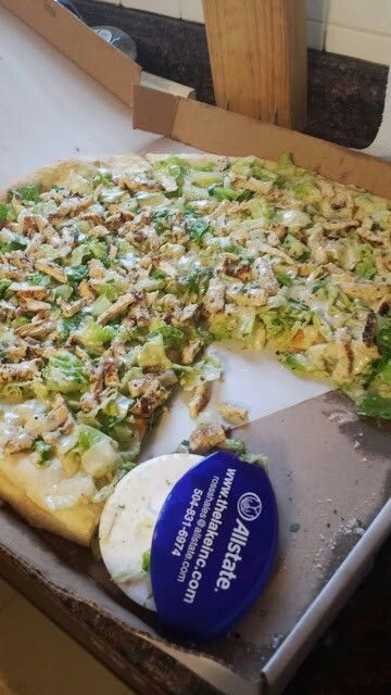 Grilled chicken Cesar pizza. Cook pizza crust in the oven first then once it's done cover our with Roman lettuce, chopped grilled chicken, and Cesar dressing. Defiantly something I'll be making at home. It's so good!