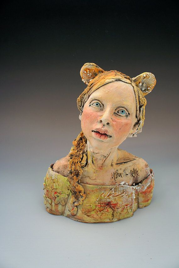 This is a ceramic bust made from earthenware clay. It stands approximately 10 inches high. The words You and Me are incised into her upper