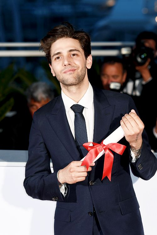 """awardseason:  """" Xavier Dolan poses with the Grand Prix for the movie 'Just the End of the World' at the Palme D'Or Winner Photocall during the 69th annual Cannes Film Festival at the Palais des Festivals on May 22, 2016 in Cannes, France.  """""""
