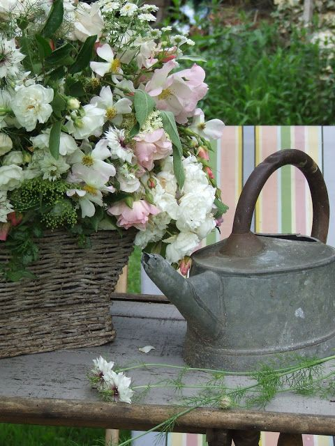 35 best images about old watering cans on pinterest gardens flower and pansies - Rustic flower gardens ...