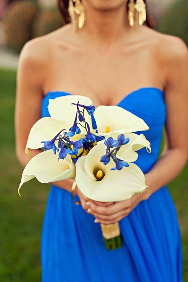 elegant white cally lily wedding bouquet with blue bridemaid dress