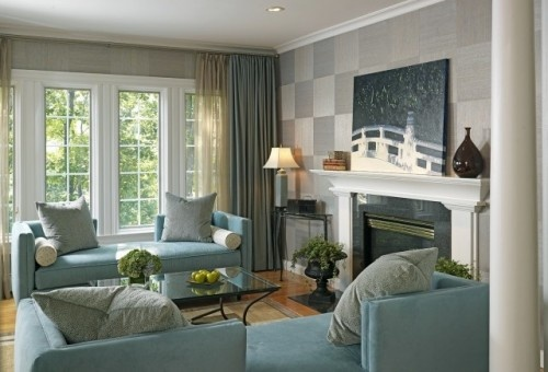 Love the soft blue sofa.  Great open backs allow for 2 way conversational seating