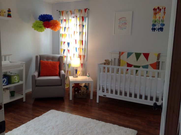 Nursery Rainbow primary colors with white furniture and accents. Love the brightness and simplicity here.