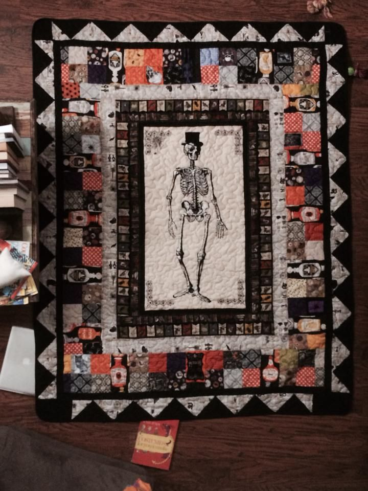 My Halloween quilt I made with blocks and panels from Chillingsworth fabric.  So fun with skeletons and old dictionary type