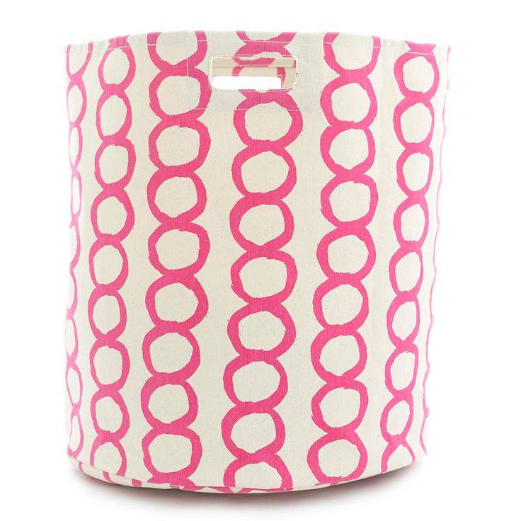 """A modern circle graphic in fresh fuchsia makes this large, durable woven cotton hamper a stylish storage solution for the laundry room, bedroom, closet, or kids spaces. Part of our exclusive collaboration with Pehr Designs, Pilar coordinates with any of our fuchsia C3 bedding and bath accessories, including towels, shower curtains, bath mats, and window panels.  • 100% cotton.  • 18"""" x 20"""".  • Screen printed.  • Circular bin with 1 seam and built-in handles."""