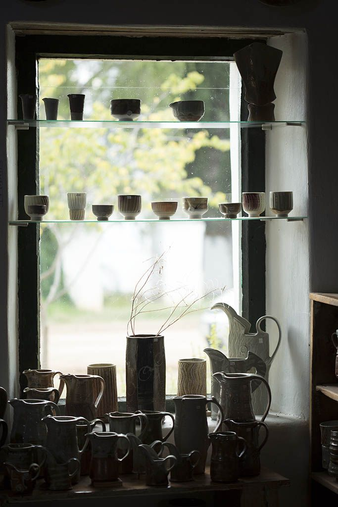 Jugs and teabowls on display