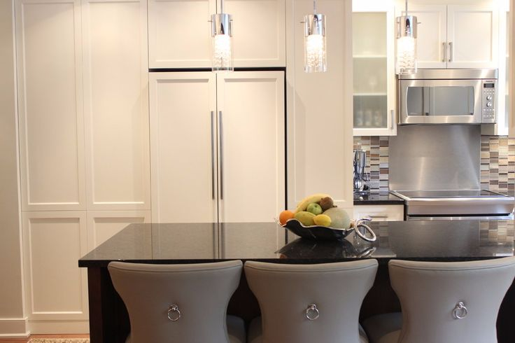 Condo perfect kitchen! Don't compensate style for space. Black granite counter bar and lots of stylish white cabinets for storage! More amazing kitchens to discover with SCD Design & Construction!