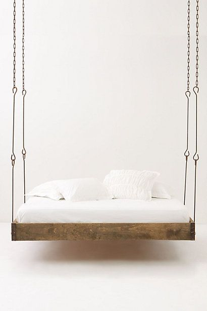 "Barnwood Hanging Bed- Framed in sleek, minimalistic pinewood and suspended from sturdy chains, this piece hovers just above the ground as it sways you into a peaceful sleep. Professional installation recommended Pinewood 85""L, 65""W, 8""D USA $3298"