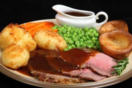 English Sunday Roast Dinner: Roast Meat (see below), Roast Potatoes, Vegetables (typically carrots, peas, and/or broccoli), Gravy, and then... Beef is served with Horseradish Sauce & Yorkshire Pudding; Pork is served with Apple Sauce & Crackling; Lamb is served with Mint Sauce; Chicken is served with Bread Sauce & Stuffing; Turkey is served with Cranberry Sauce & Stuffing