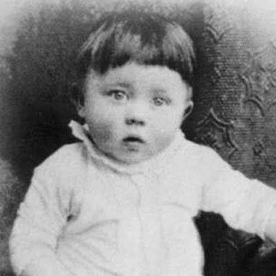 Adolf Hitler as a baby. The atrocities and  insanity he would grow up to commit need no introduction.