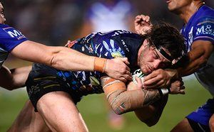 Ethan Lowe of the Cowboys surges to the try line to score his try during the round 20 NRL match between the North Queensland Cowboys and the Canterbury Bulldogs.