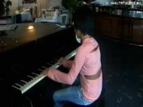 yulia volkova playing the piano