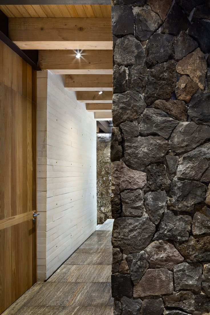 Stone fireplace with reclaimed bargeboard finish contemporary - This House In Mexico Is Made Up From A Series Of Concrete Boxes Which Are Staggered Across A Steep Site To Take In Views Of Lake Av Ndaro