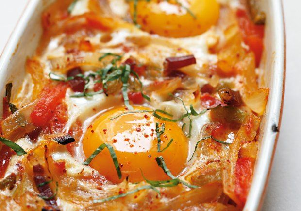 Nestled in a bed of vegetables, these healthy eggs make for an all-around classy brunch.