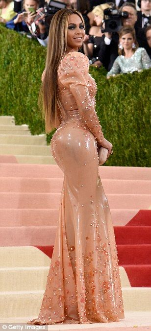How did she get it on? Bey showed off her curves in the impossibly tight gown which also featured pearls