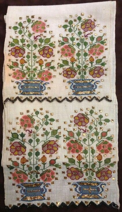 An 'uckur' (waistband/sash) with embroidered ends.  From western Anatolia, late 19th c.  The embroidery is 'two-sided' (identical on both sides of the fabric) and is executed in both multi-coloured silk and 'tel kırma' (motives obtained by sticking narrow metallic strips through the fabric and folding them.).