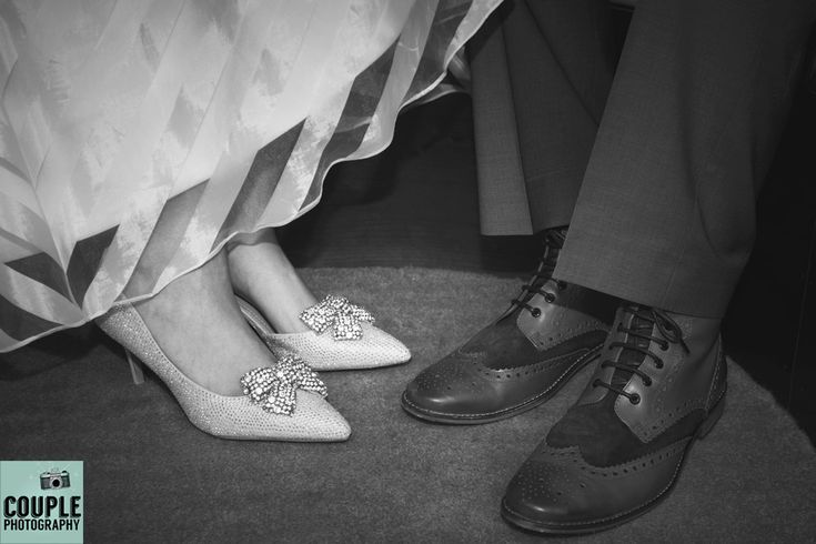 The bride shows of her diamante bow shoes & the groom tries to compete with his colorfull brogues. Weddings at Kinnitty Castle photographed by Couple Photography.
