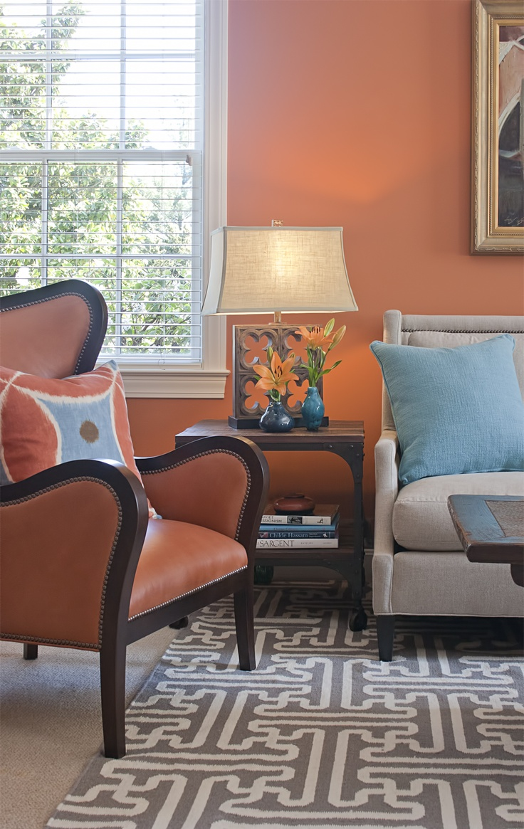 Living room setting with leather chair, upholstered sofa ...