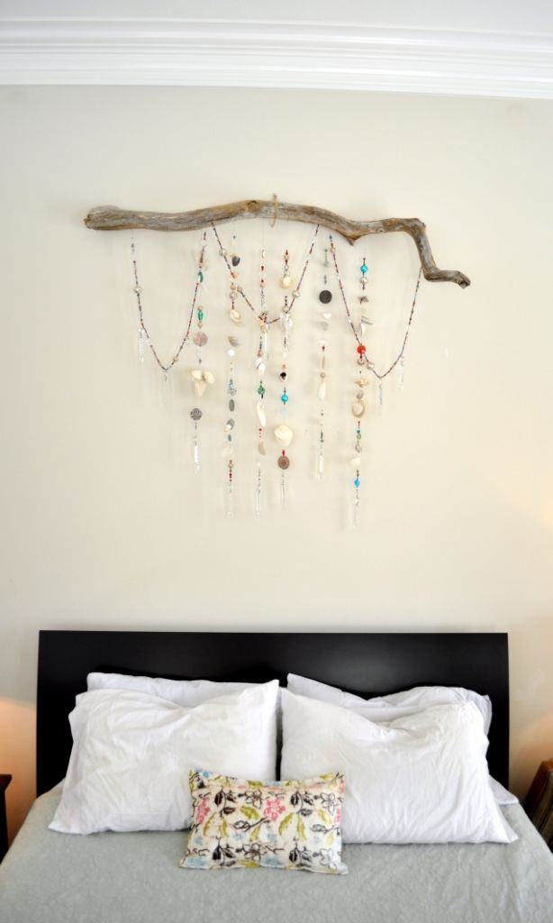 Bedroom sparkle - wall hanging made from strands of beads, seashells, chandelier prisms, buttons, & pieces of jewelry hanging from a driftwood branch.