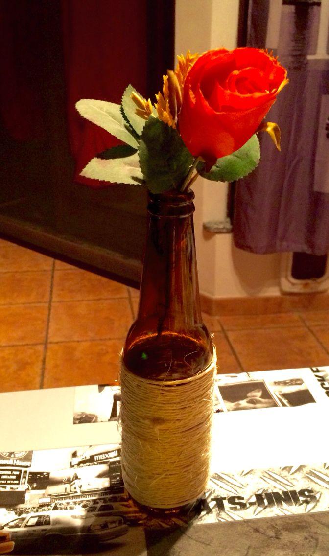 Bottiglia decorata porta fiori