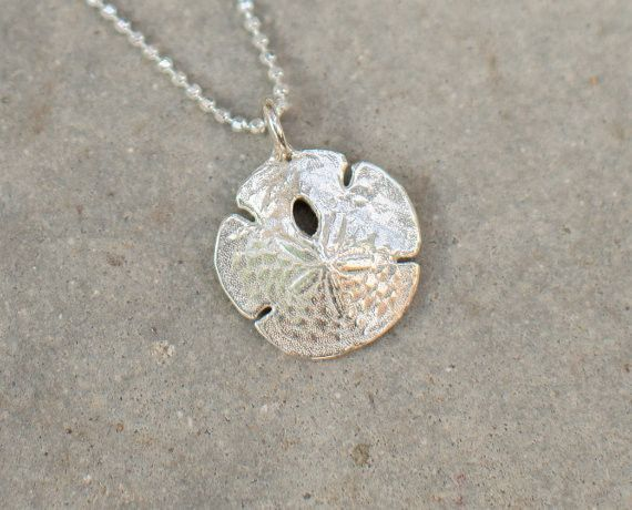 """This is a 1"""" sterling silver sand dollar charm cast from the actual item. The back is hand stamped """"Abundance"""". The charm comes with a faceted 18"""" sterling silver chain. All items are designed and cas"""