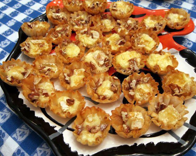 Brie Bites: brie, honey, brown sugar, chopped pecans, wonton wrappers or mini phyllo tarts. YUM.