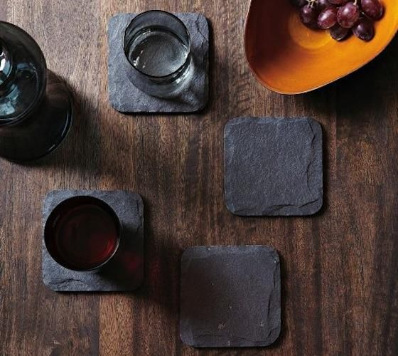 Slate Coster Set - Sleek and sophisticated, these naturally edged slate coasters are mounted onto velvet to protect counter tops and tables. Perfect for any occasion, use these coasters for all of your favorite beverages.