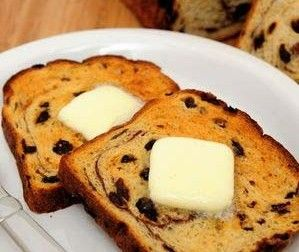 Gluten Free Cinnamon Raisin Bread.  Recipe uses a bread machine.