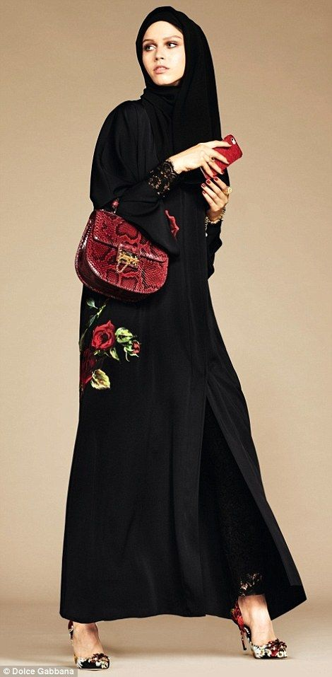 Lush red roses, which feature in D&G's Spring 2016 collection, add a splash of colour and flair to this black abaya