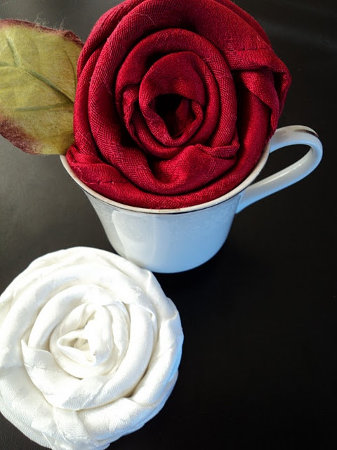 Napkins made to look like roses on your table.