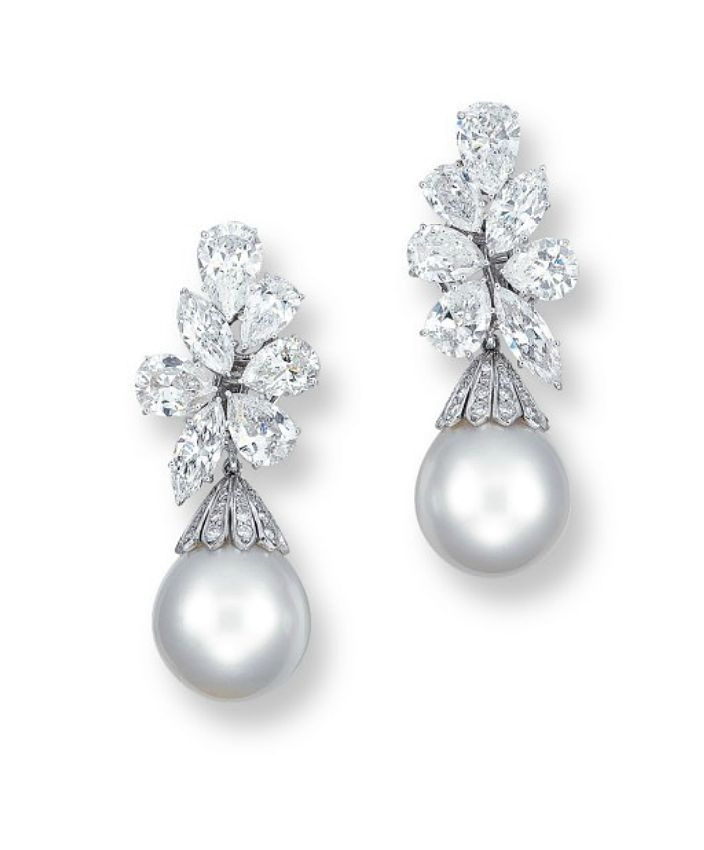 A PAIR OF DIAMOND AND CULTURED PEARL EAR PENDANTS, BY HARRY WINSTON Each pear and marquise-cut diamond cluster suspending a detachable oval-shaped white cultured pearl measuring approximately 15.9 to 16.0 mm, mounted in platinum, 4.8 cm long, in blue leather Harry Winston case Signed and with maker's mark for Harry Winston
