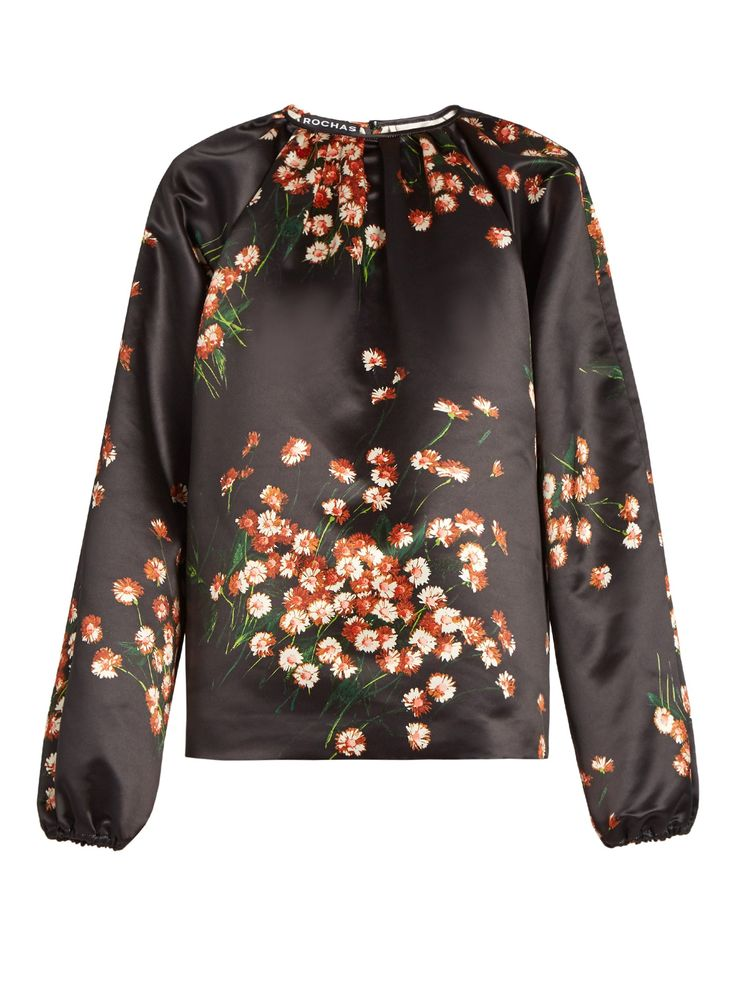 Daisy-print duchess-satin top    Rochas   MATCHESFASHION.COM  Master the new season's dark florals with Rochas's black duchess-satin top. It's patterned with wild daisies and cut to a voluminous silhouette with long gathered sleeves. Pastel-pink trousers will sweeten the look, while a deep burgundy pair will increase the moody allure.