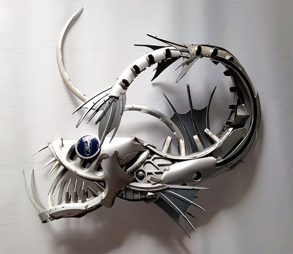 Old Hubcaps Recycled Into Stunning Animal Sculptures Brighton, UK-based artist Ptolemy Elrington has been morphing discarded hubcaps into amazing animal sculptures.-