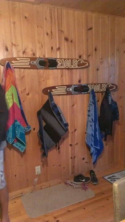 Beach towel racks made from old water skis and hooks.