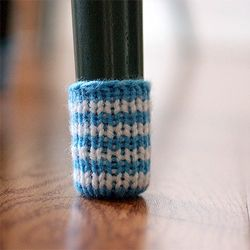 Knit Chair Socks - my next knitting project ;)  Got to be better than the sticky pads that fall off.
