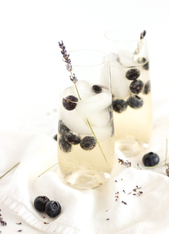 Delicate, floral Blueberry Lavender Sangria is a delicious, elegant cocktail to serve at all of your spring gatherings. It's so easy to make but tastes impressive! | via livelytable.com