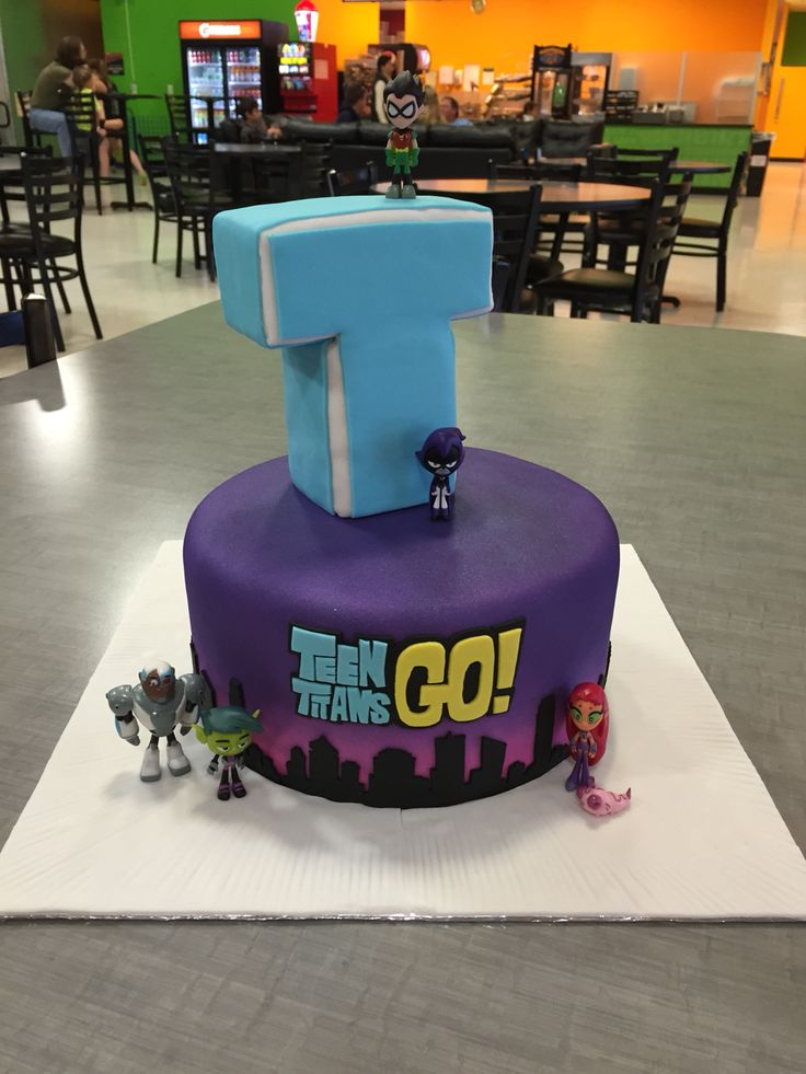 Teen Titans Go cake with a vanilla buttermilk cake. The purple and pink sky is airbrushed and the Titans Tower is made from Rice Krispie Treats