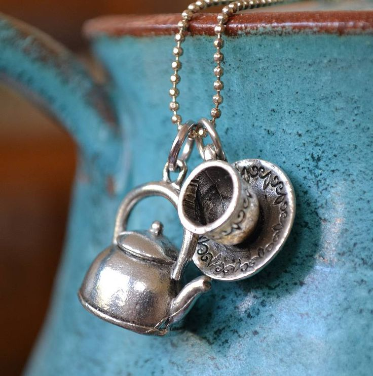 WOW! Delivery to the US is almost $30!! I would love to have one though, wouldn't you?    Tea Cup And Pot Charm Necklace