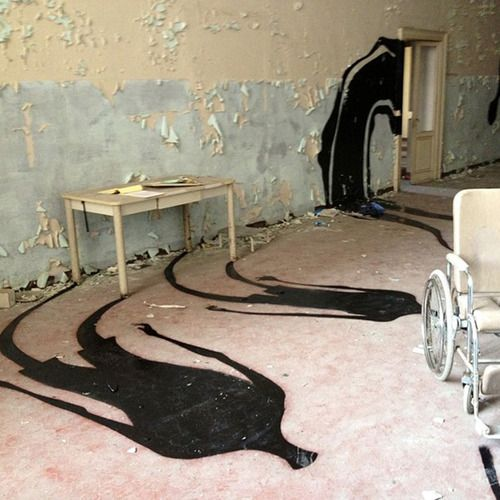 """Creepy Art in Abandoned Psychiatric Hospitals  For a project entitled """"1,000 Shadows,"""" Brazilian street artist Herbert Baglione invaded abandoned hospital wards in Madrid, Paris and other undisclosed locales to add ghostly shadows to the already eerie buildings.  Spindly, stretched ghosts emerge under doors, float through windows and emerge out of objects' shadows."""