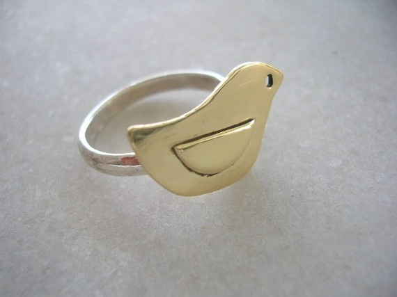 brass and sterling silver bird ring - made to order. $38.00, via Etsy.