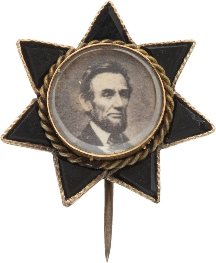 "Abraham Lincoln: Dainty Portrait Brooch. Diminutive 5/8"" brooch in the shape of a seven-pointed star. It houses an albumen bearded ..."