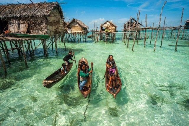 Living on Water in Malaysia  Malaysian photographer Ng Choo Kia, member of SIPA Press, has been joined the Bajau people in Malaysia. Residents have the characteristic of leaving on water. Their houses are on stilts and overhang transparent and turquoise water.
