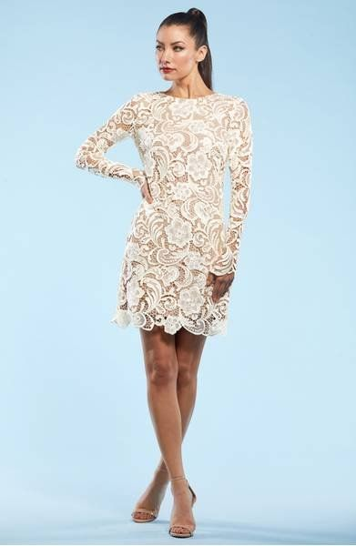 Long sleeves balance the short hemline of an elegant shift covered in sprawling floral crochet and finished with an intricate scalloped hem.