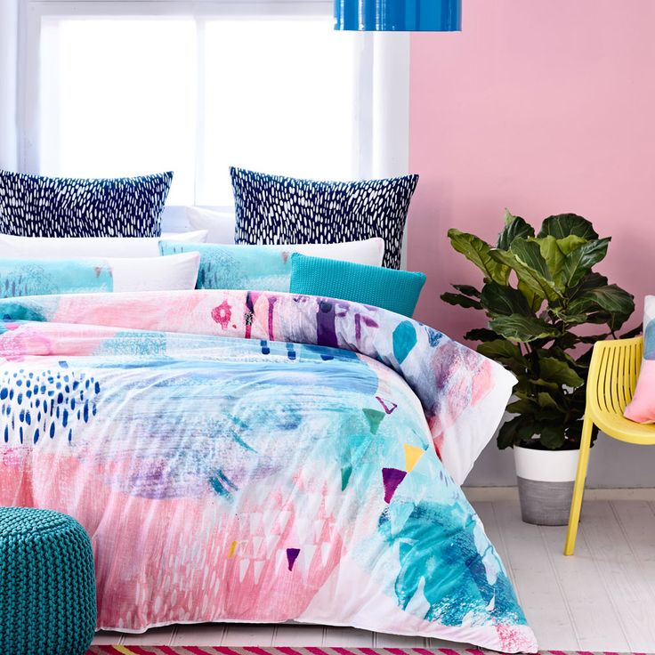 Exclusively hand painted by the Adairs design team, the Picasso quilt cover set recreates the collaboration of colour, pattern and texture found on an artist's canvas. This exquisite watercolour design is printed onto a luxuriously soft cotton percale and features a cool blue triangle print reverse for an alternate styling option. Combine with coordinating navy patterned European pillowcases for a complete look. Â