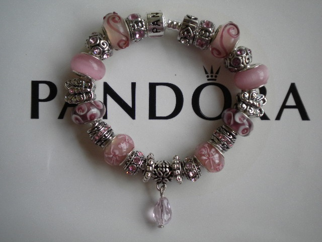 My Pandora Embossed Bracelets that I make and sell for $125. The bracelets are silver plated and embossed with pandora and 925 Silver. The Murano Glass beads are of High Quality and all have silver cores. The charms are 925 silver, antique silver and silver plated. You can see all of my bracelets on ebay, just click this link> http://www.ebay.com/sch/gingersgems2011/m.html?item=300686462430=STRK%3AMESELX%3AIT&_trksid=p3984.m1555.l2649&_trksid=p4340.l2562Antiques Silver, Glasses Beads, Embossing Bracelets, Silver Plates, 925 Silver, Murano Glasses, Silver Cores, High Quality, Pandora Embossing