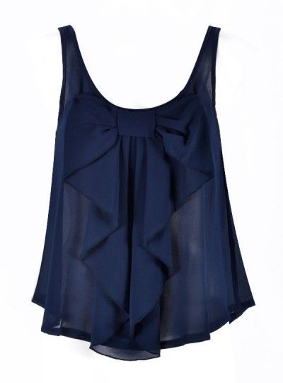 Dark blue top with ruffles and a bow.