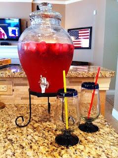 Champagne punch  1.5 L champagne  2 L ginger ale  12 oz can of frozen lemonade (I use pink lemonade)  frozen raspberries