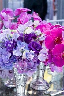 Sweet peas, lisianthus and hydrangeas in shades of purple and hot pink orchids